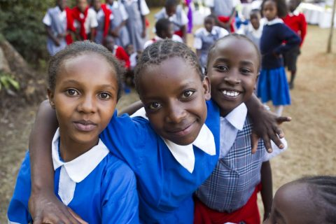 Photo of smiling young school girls