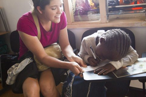 Young woman teaching a Ngong Road student